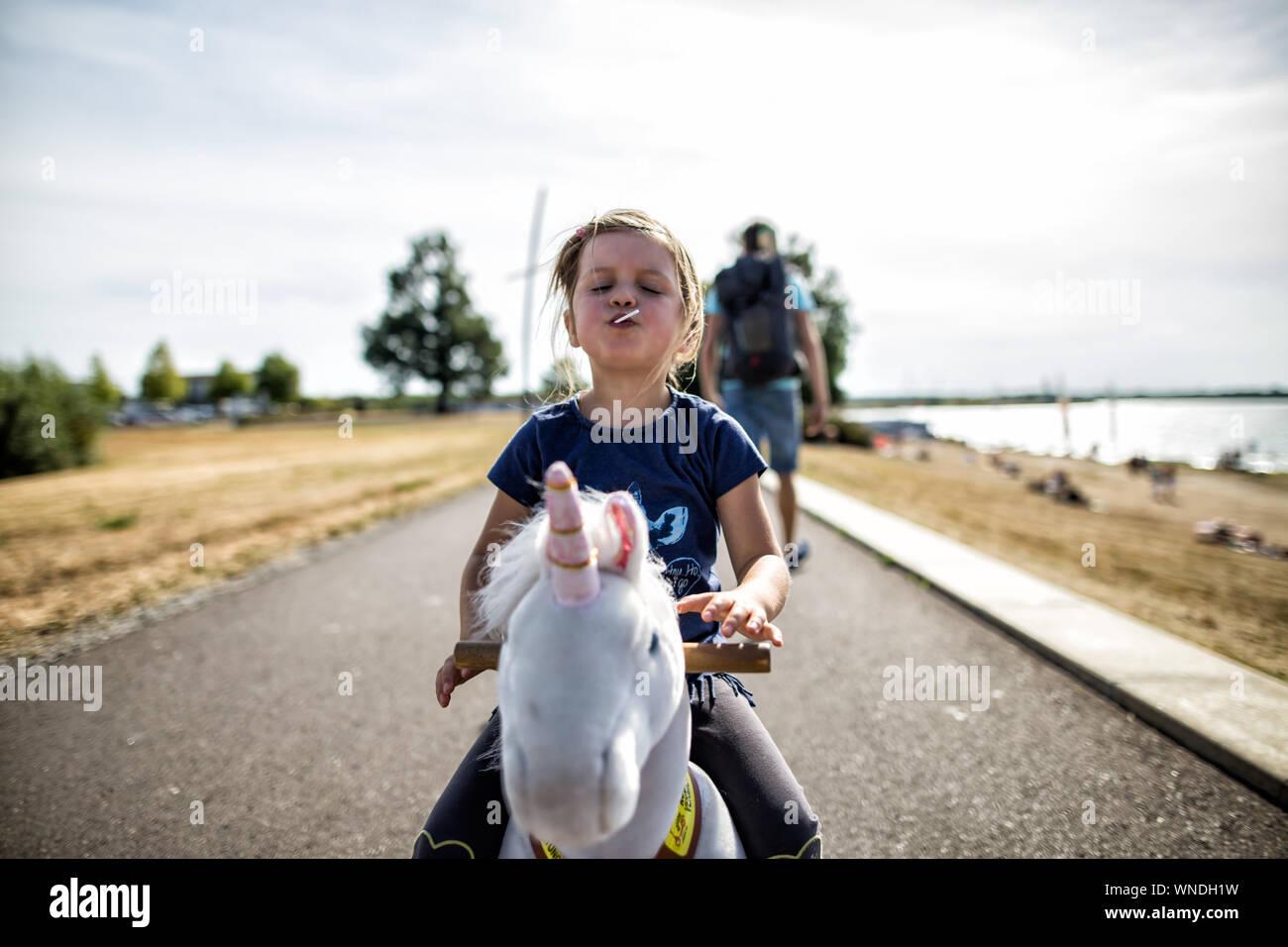 Child Sitting On Rocking Horse Stock Photo Alamy