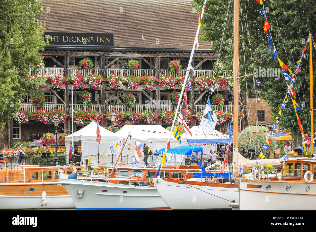 St. Katharine Docks, London, 06th Sep 2019.Classic boats and barges, including the Royal barge Gloriana, decorated smaller vessels and water craft are moored in St. Katharine Docks for the annual Classic Boat Festival. The free festival also features food and drink stalls, stages, bands and free paddle boarding and other activities, and is on for three days until Sunday 8th September. Credit: Imageplotter/Alamy Live News Credit: Imageplotter/Alamy Live News Stock Photo