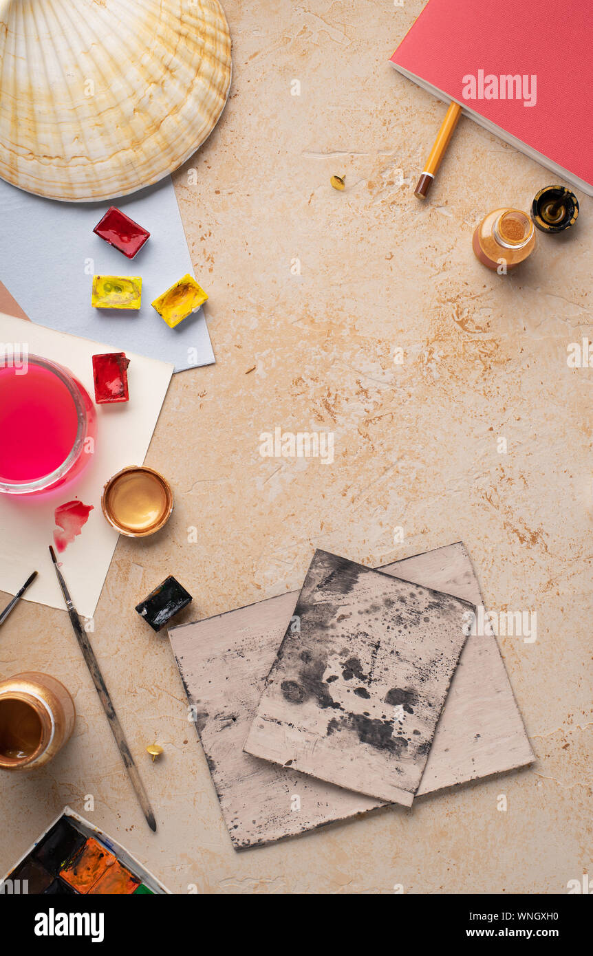 Artist's workspace flatlay. Art equipment on rustic background. View from above with copy space. Stock Photo
