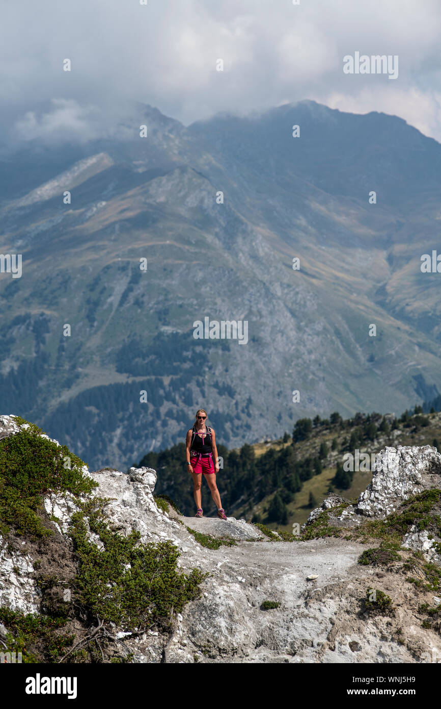 A Woman Hikes On A Ridge Trail At High Altitude On La Crête