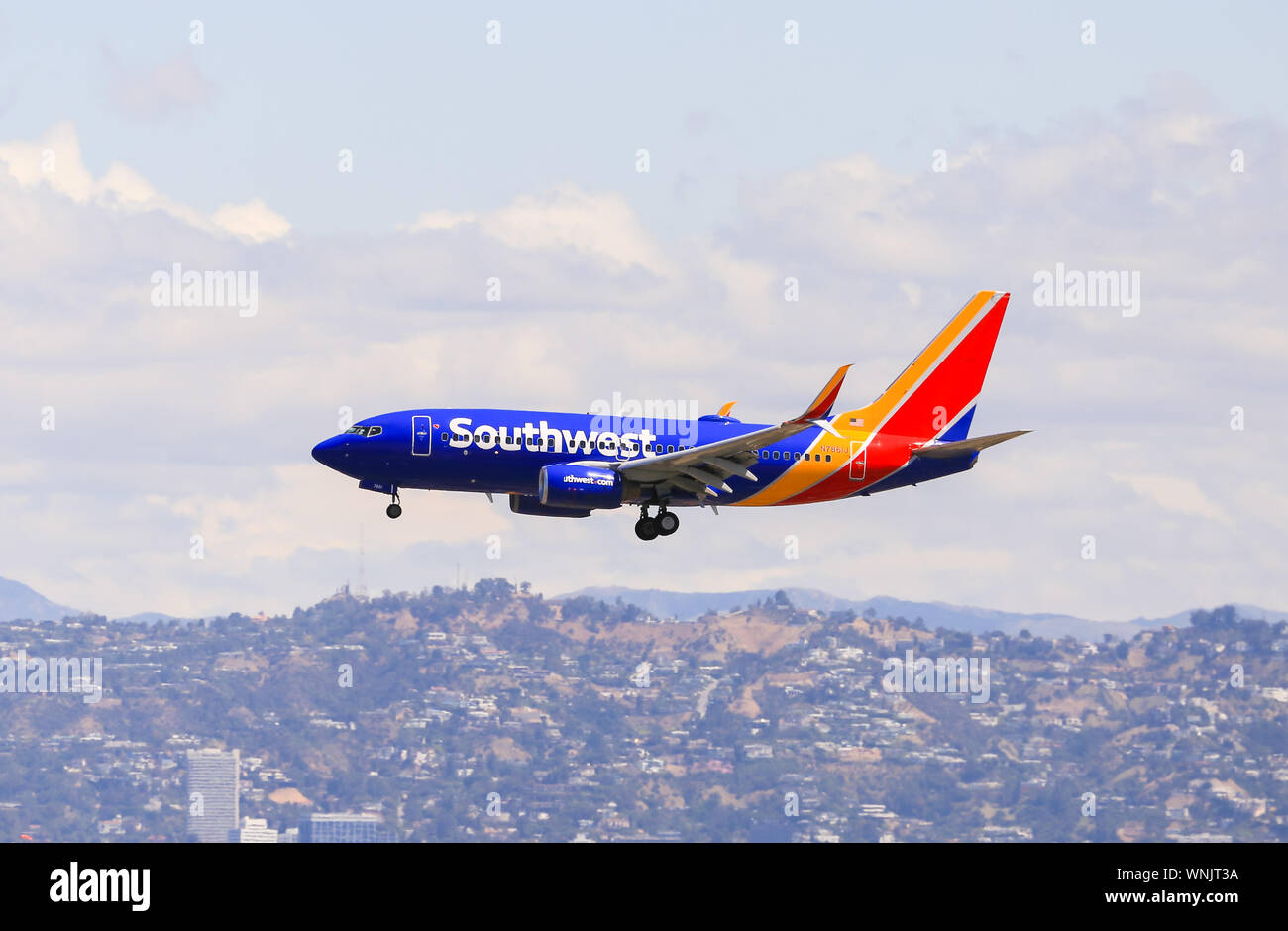 Los Angeles, California, USA - May 22, 2019: A Southwest Boeing 737 lands on the Los Angeles International Airport (LAX). Stock Photo