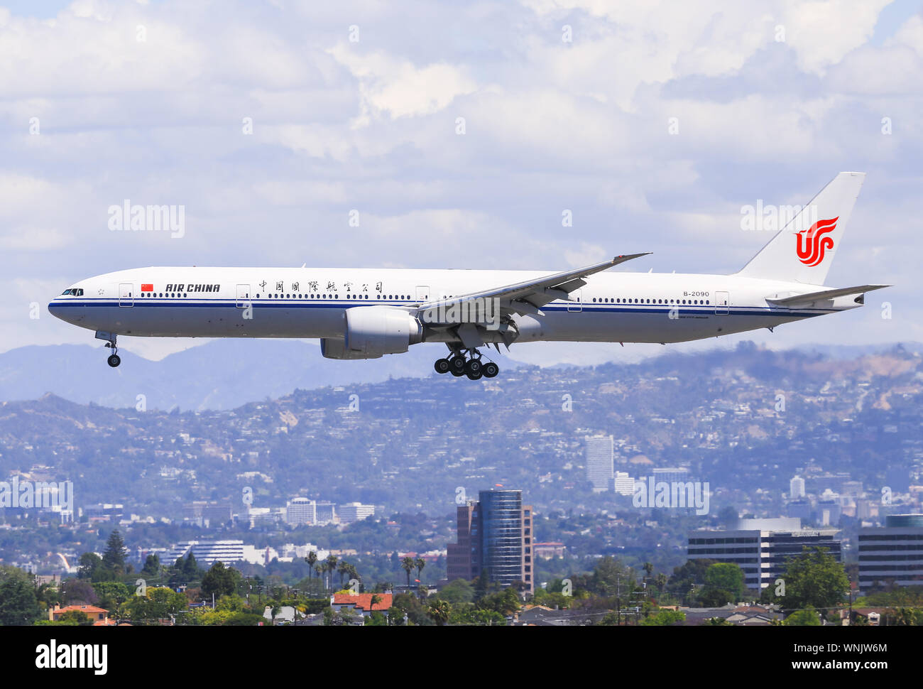 Los Angeles, California, USA - May 22, 2019: An Air China Boeing 777 lands at the Los Angeles International Airport (LAX). In the background you can s Stock Photo