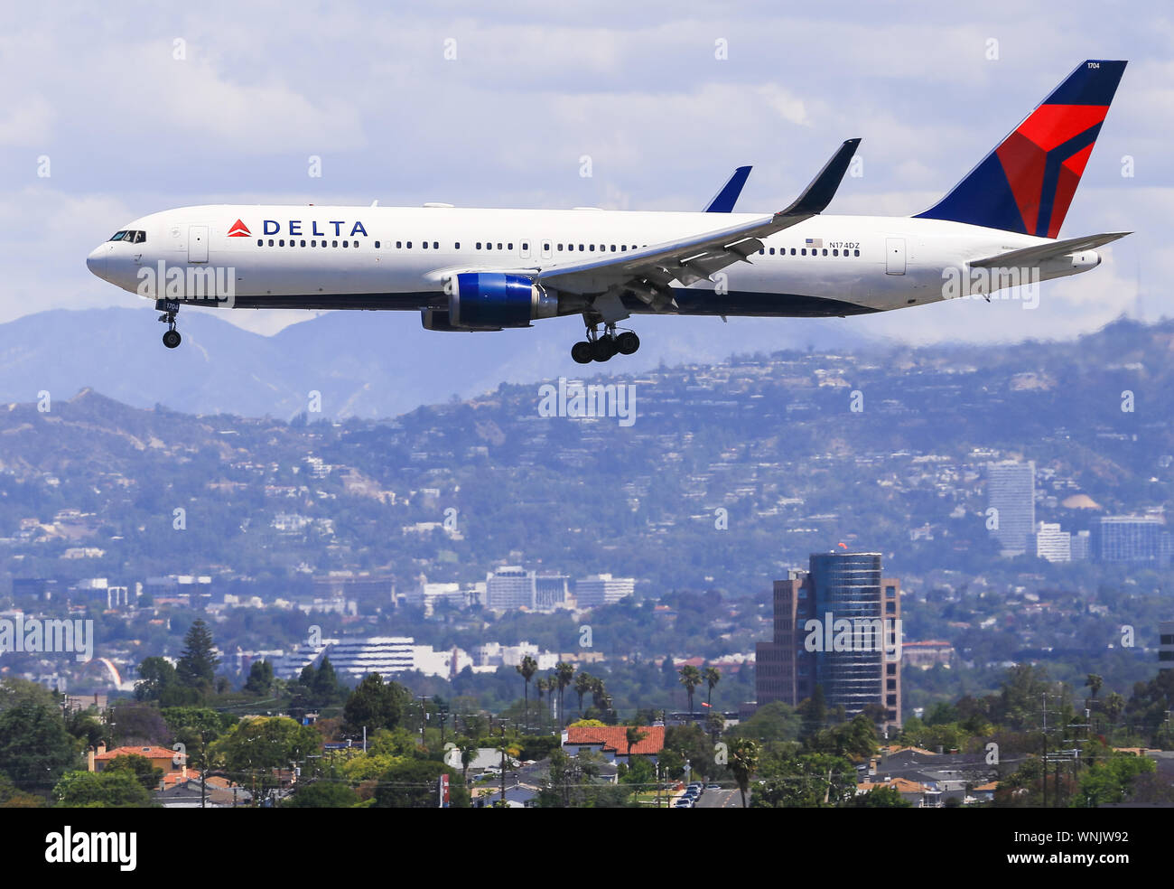 Los Angeles, California, USA - May 22, 2019: A Boeing 767 from Delta Airlines lands at the Los Angeles International Airport (LAX). In the background Stock Photo