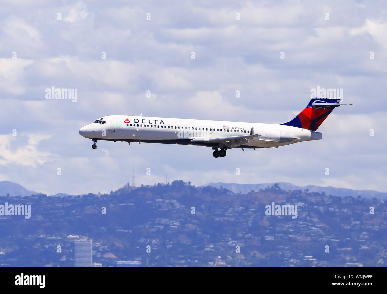 Los Angeles, California, USA - May 22, 2019: A Boeing 717 from Delta Airlines lands at the Los Angeles International Airport (LAX). In the background Stock Photo