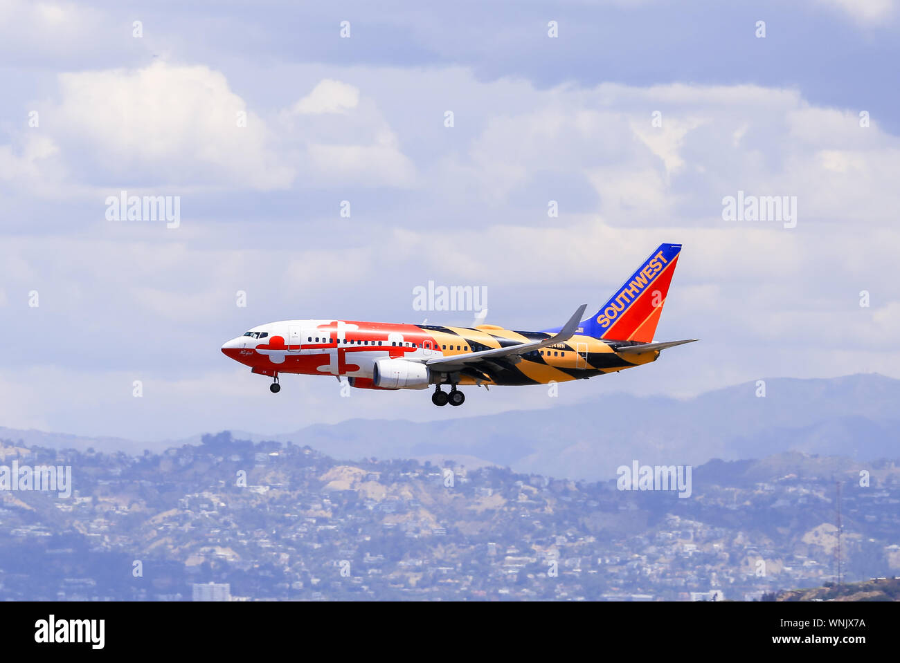 Los Angeles, California, USA - May 22, 2019: A Southwest Boeing 737 (Maryland One) lands at the Los Angeles International Airport (LAX). Stock Photo