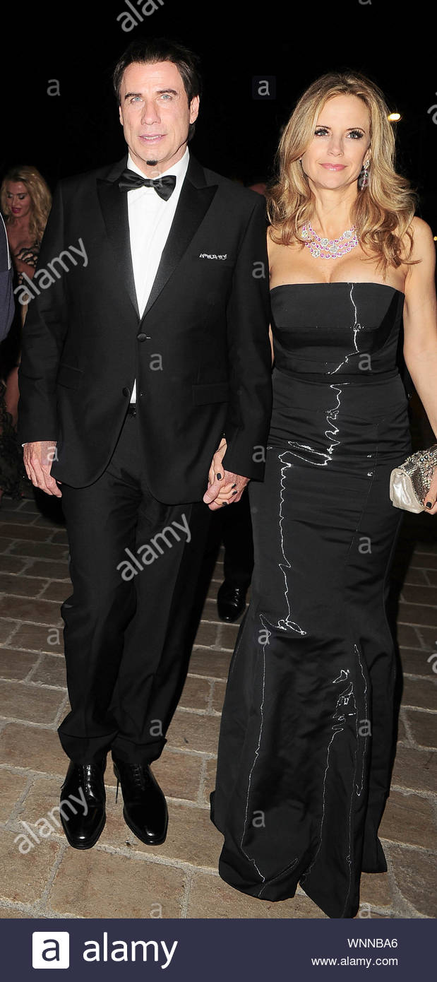 Cannes, France - John Travolta and Kelly Preston at Roberto Cavalli's annual yacht party at Cannes Harbor during the 67th Annual Cannes Film Festival in Cannes, France. AKM-GSI May 21, 2014 Stock Photo