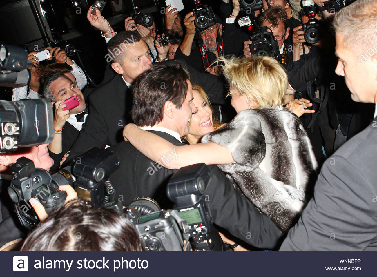 Cannes, France - John Travolta and Kelly Prestoni at Roberto Cavalli's annual yacht party at Cannes Harbor during the 67th Annual Cannes Film Festival in Cannes, France. AKM-GSI May 21, 2014 Stock Photo