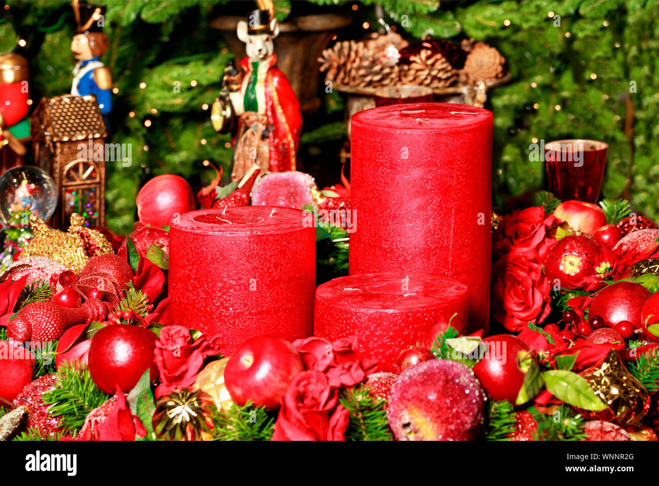 Fairytale Christmas Decorations.Christmas Decoration Three Thick Red Candles Surrounded By
