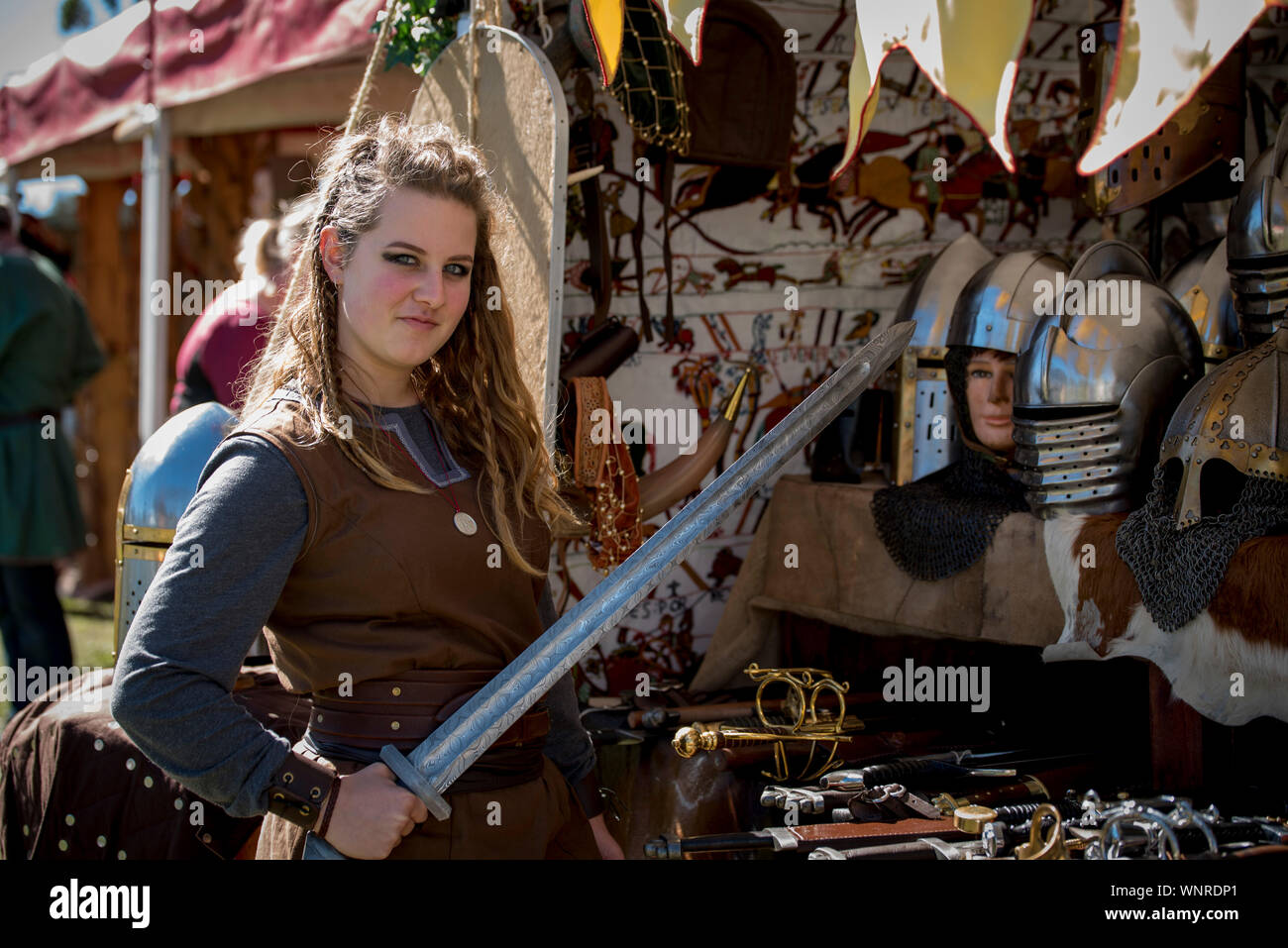 Portrait Of Confident Young Woman Holding Artificial Sword