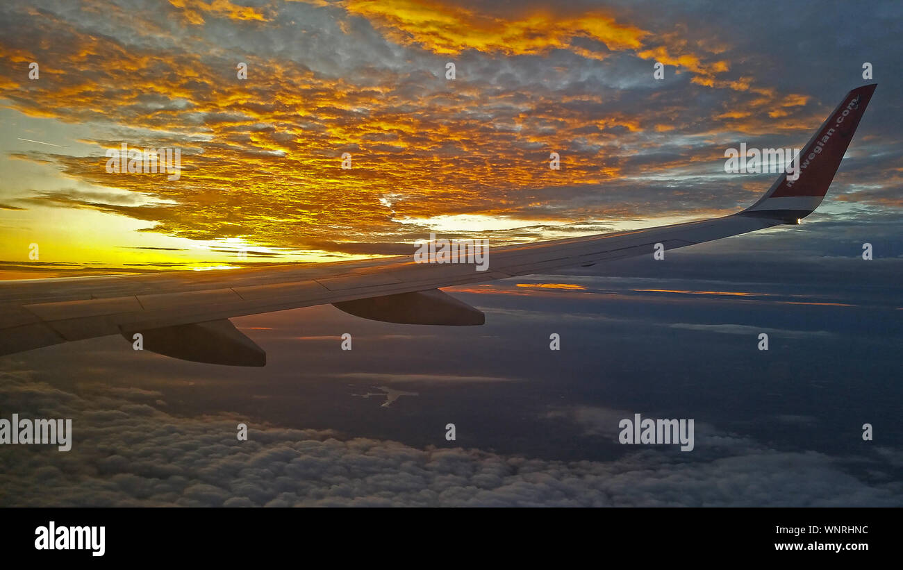 Sunset view from airplane window. Stock Photo