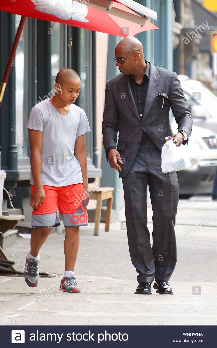 new york ny a dapper looking dave chappelle and son sulayman stop by a convenience store https www alamy com new york ny a dapper looking dave chappelle and son sulayman stop by a convenience store in soho new york dave was well dressed in a black and grey suit and black leather dress shoes as he puffed on a smoke and walked with his oldest son akm gsi june 10 2014 image271588390 html