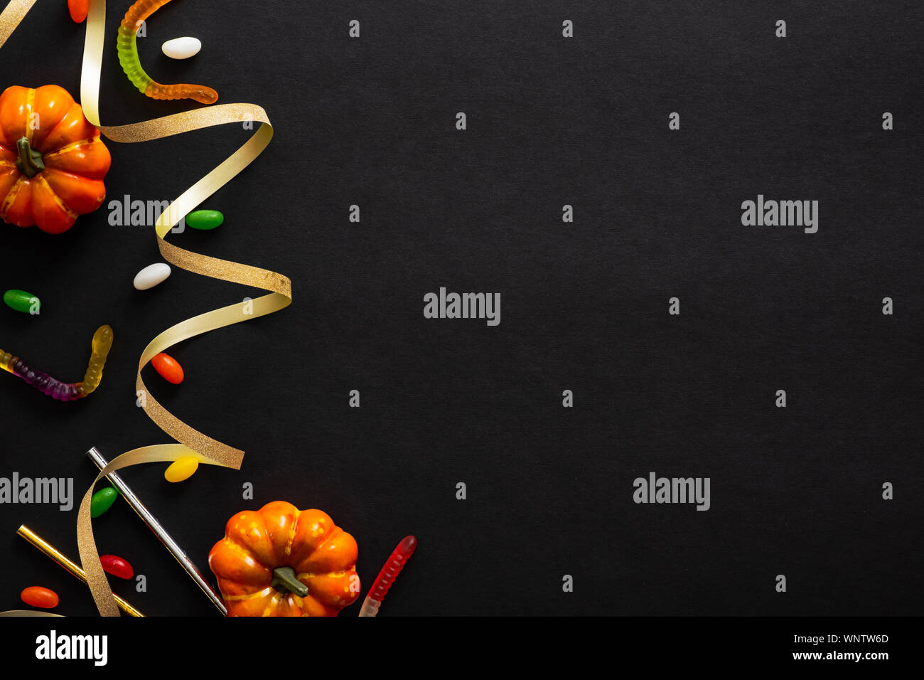 Halloween Dark Background With Pumpkins Candy Gold Ribbon