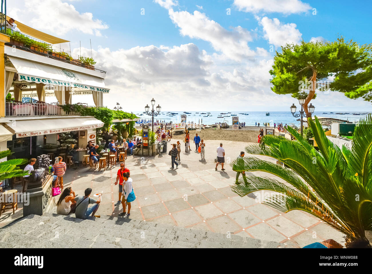 The sandy beach, cafes and shops at the coastal town of Positano Italy on the  Amalfi Coast of the Mediterranean Sea Stock Photo