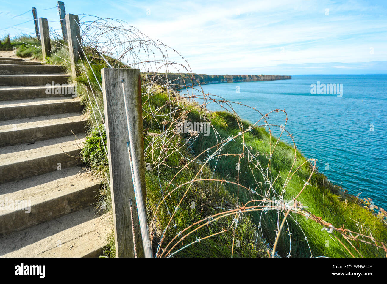 The coast of Normandy France, Pointe du hoc where the allied forces faced the Germans during World War 2, with barbed wire, Stock Photo