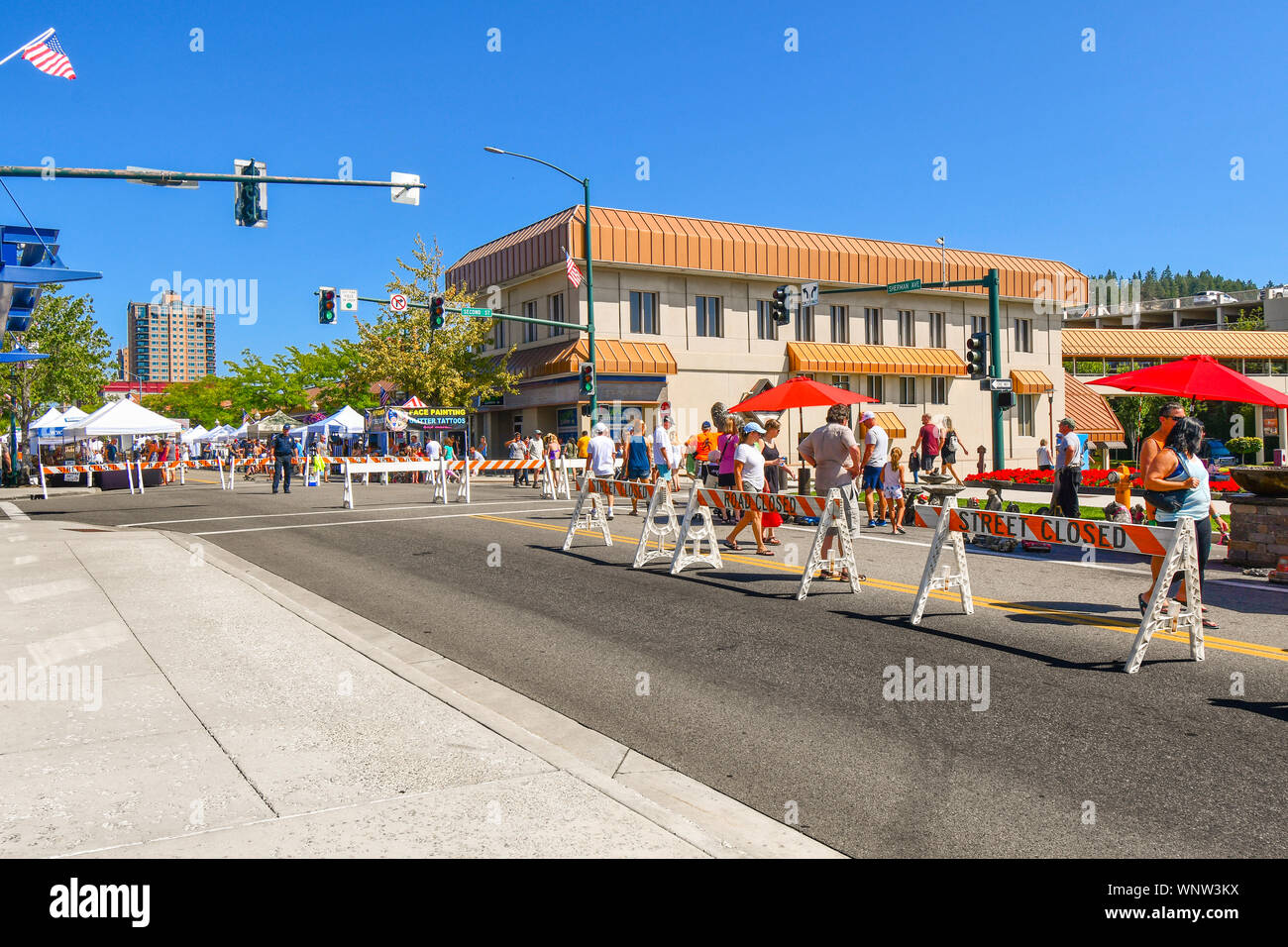 Tourists and local Idahoans enjoy the annual street and art fair in the Inland Northwest town of Coeur d'Alene, Idaho, USA Stock Photo