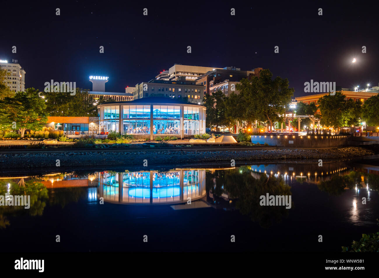 Evening at the illuminated Looff Carousel which runs along the Spokane River at Riverfront Park in Downtown Spokane, Washington Stock Photo