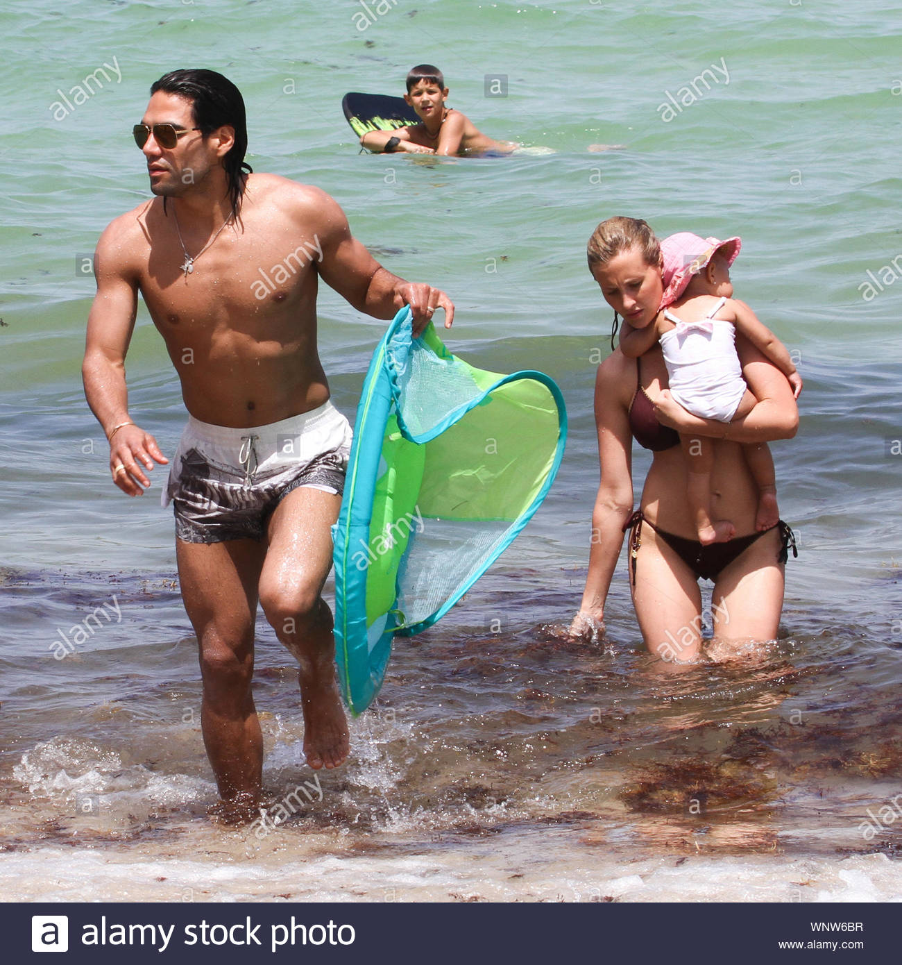 Miami, FL - Radamel Falcao García Zárate, commonly known simply as Radamel Falcao, his wife Lorelei Taron and their cute baby Dominique soak up the Miami Sun, Falcao is a Colombian football striker, who plays for AS Monaco in the French Ligue 1 and represents the Colombia national football team. AKM-GSI June 20, 2014 Stock Photo