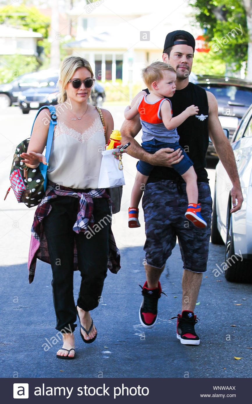 "Beverly Hills, CA - Hilary Duff and ex Mike Comrie take their little son Luca out for breakfast at a local restaurant in Beverly Hills. Since announcing their split in January, the two have surprised fans by subsequently taking a ""Modern Family"" vacation together with their tot, and even rocking out, sans Luca, at the Coachella Music and Arts Festival last month. AKM-GSI June 21, 2014 Stock Photo"