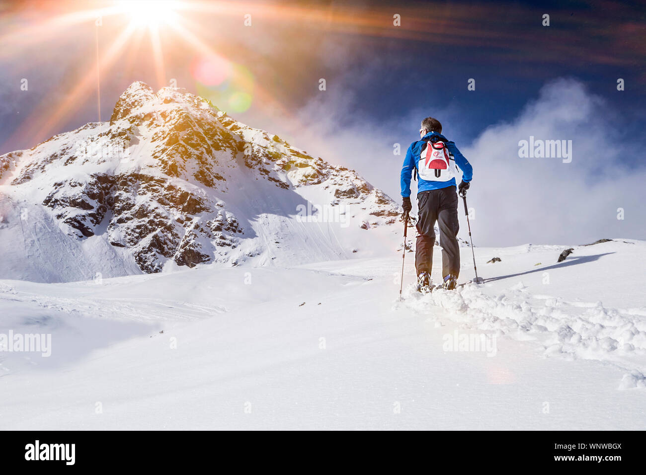 Full Length Of Man Standing On Snow Covered Landscape Stock Photo
