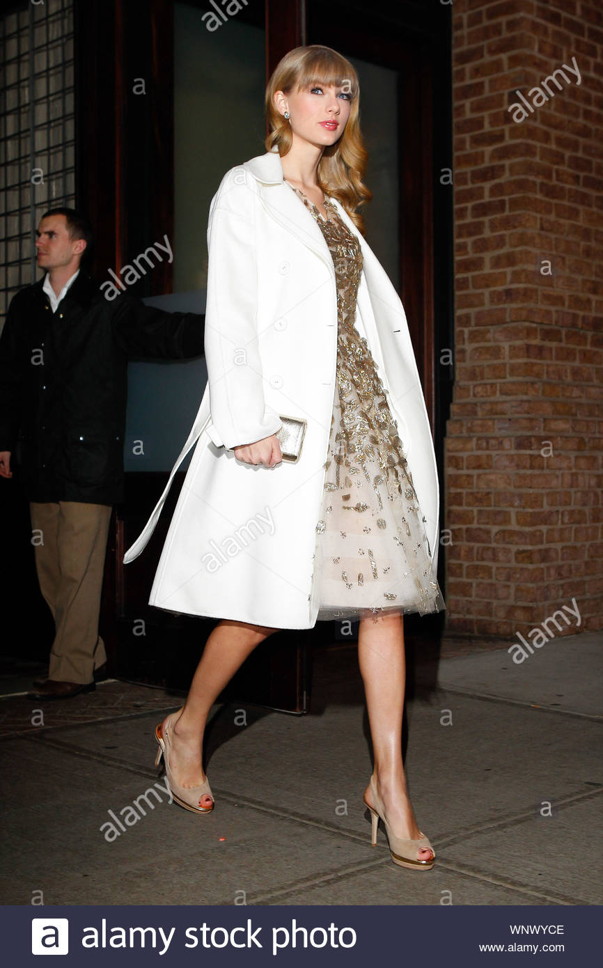 New York Ny Singer Taylor Swift Leaves Her New York Hotel Looking Great Taylor Wore A White And Gold Night Dress With A White Coat On Top And Matching Designer Shoes