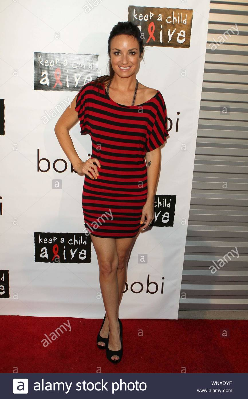 """West Hollywood, CA - Revolve Clothing hosted the bobi Sample Sale For A Cause event showcasing Kara Lusardi's bobi clothing line, with all proceeds donated to the Keep a Child Alive foundation. Stars that hit the red carpet were co-host Ali Landry (Pic 1,9,11,12,15,22), Tia Carrere (Pic 2,8,13,17,19,21,23) and co-host Sophie Monk (Pic 2,9,11,15,19,23), Chrishell Stause from """"All My Children"""" (Pic 3,16,), Kara Lusardi (Pic 4,9,11,15,18), E!'s """"D10"""" host Catt Sadler (Pic 5,), Vanessa Lengies from """"Hawthorne"""" (Pic 6,9,10,11,15,20), and Lisa Locicero from """"General Hospital"""". GSI Media June 23, Stock Photo"""