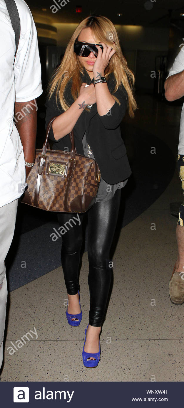 LAX Airport, Los Angeles, CA - Tila Tequila arrives at LAX Airport late last night after being involved in a scary incident in Illinois where a group of fans violently attacked her while she tried to perform on stage. The entire incident occured at the Gathering of the Juggalos concert, featuring Insane Clown Posse and Kottonmouth Kings. Reports are that the mob attacked Tila, throwing rocks, bottles and firecrackers at her on stage, then chasing her back to her trailer where they busted out all of the windows to the trailer trying to get to her. Tila reportedly suffered several cuts to her Stock Photo