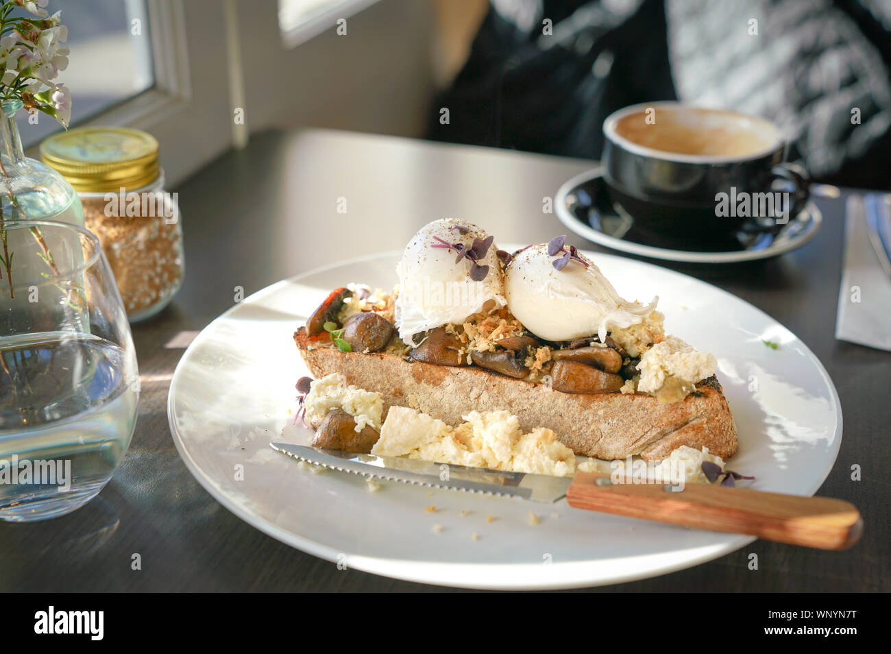 Breakfast with poached eggs and toast bread in a cafe Stock Photo