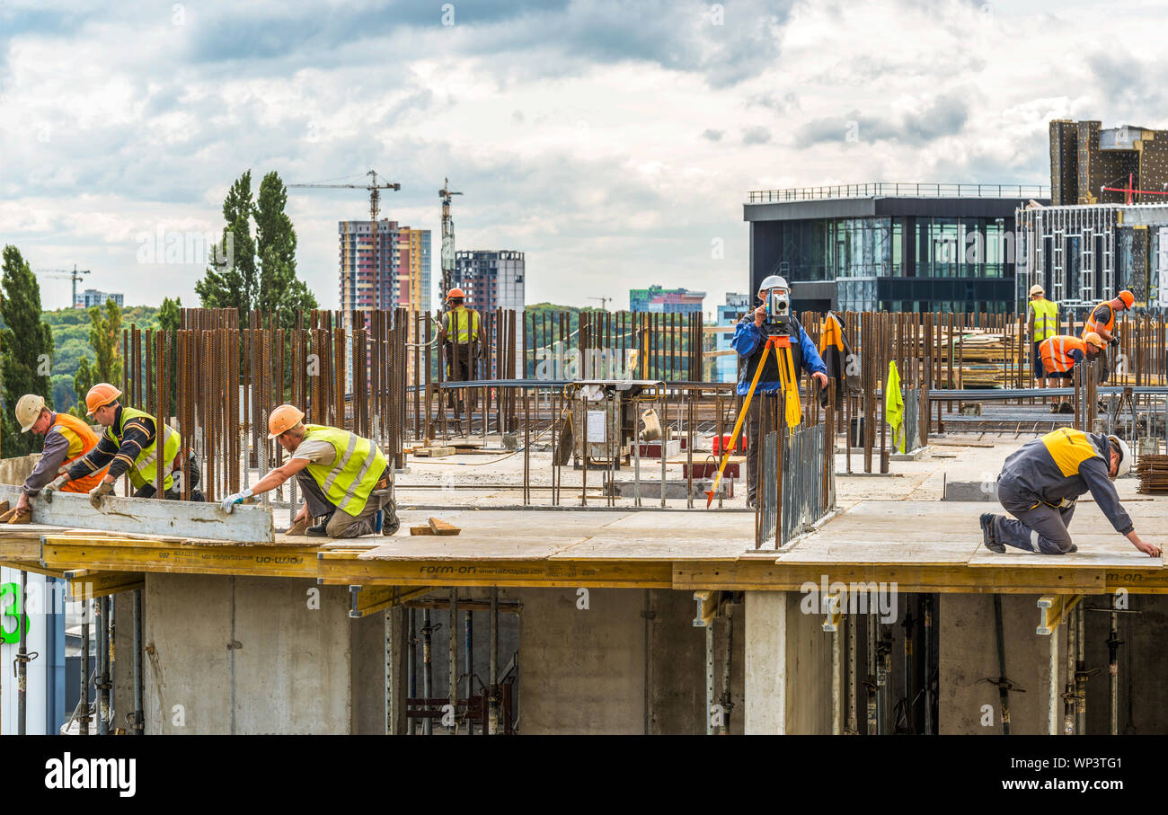 Kiev, Ukraine - September 05, 2019: Active preparatory work is ongoing for concreting at the construction site of a residential building. Surveyor eng Stock Photo