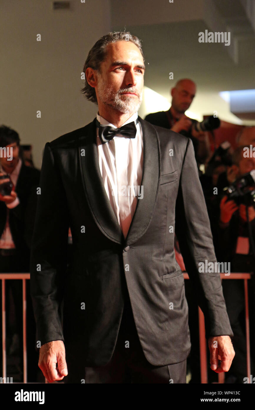 Italy, Lido di Venezia, September 6, 2019 :  Sergio Muniz, model, singer and actor spanish walks the red carpet ahead of the 'Waiting For The Barbaria Stock Photo
