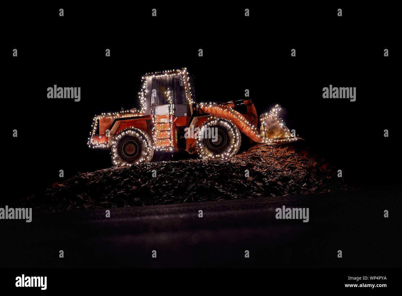 wheel loader decorated with lights at christmas Stock Photo