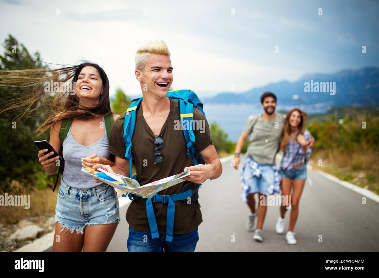 Adventure Travel Tourism And People Concept Group Of Smiling Friends With Backpacks And Map Stock Photo Alamy