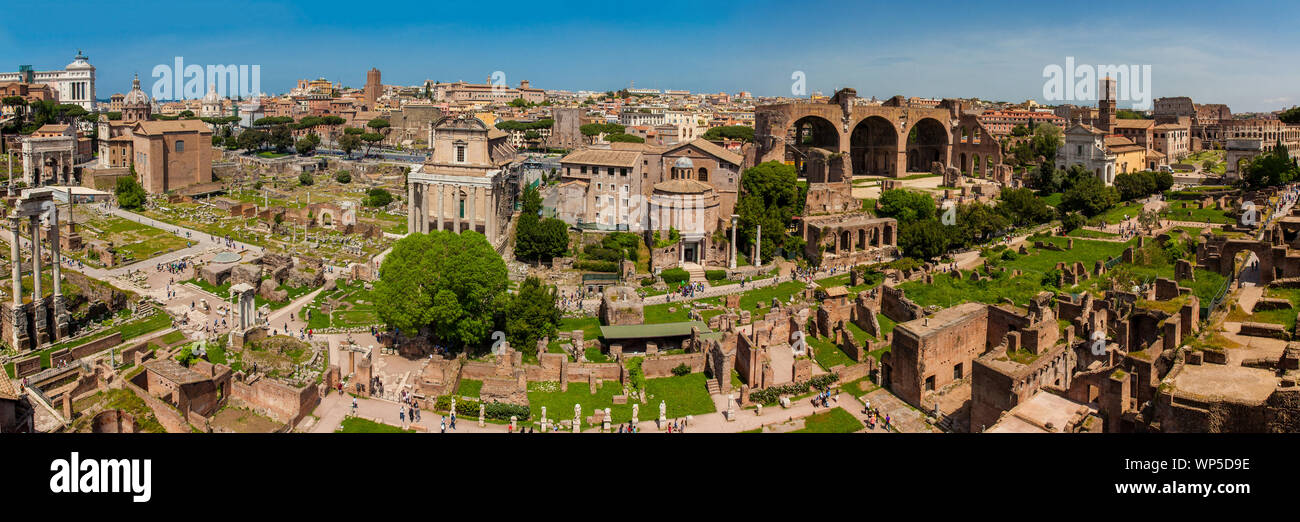 ROME, ITALY - APRIL, 2018: Panoramic view of the ancient ruins of the Roman Forum and the Colosseum in Rome Stock Photo