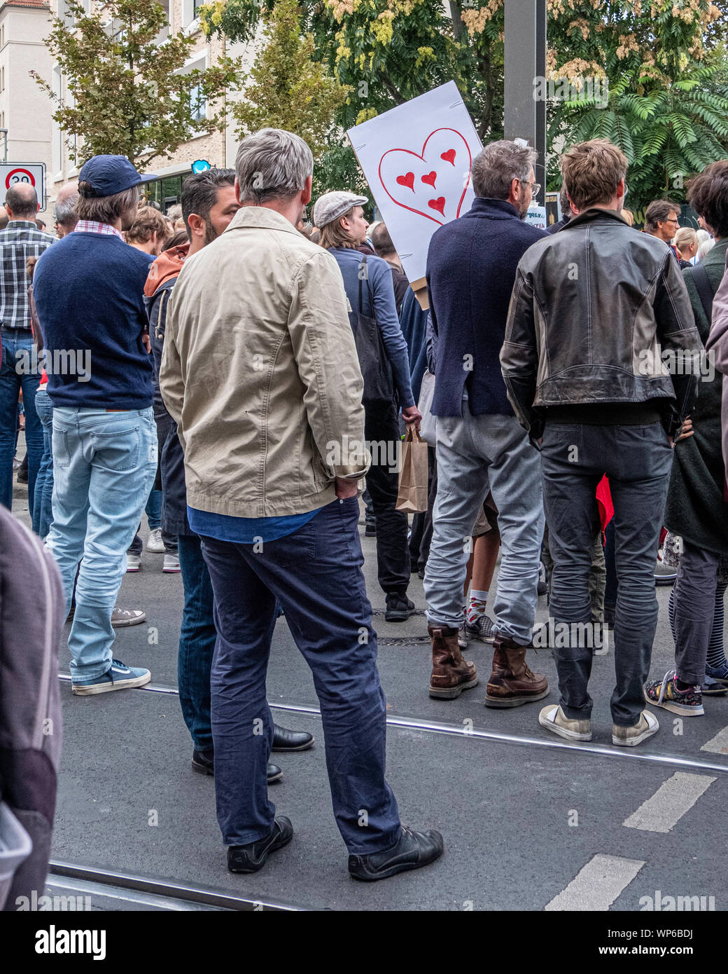Germany, Berlin, Cnr. Invalidenstrasse & Ackerstrasse. 7th September 2019.Vigil for four people killed in accident as a Porche SUV ploughed onto sidewalk of Friday evening. Berliners gathered to mourn the dead and bring flowers & candles to the site of the accident. There was also a call for SUV vehicles to be restricted in the city and for a new speed limit. credit: Eden Breitz/Alamy Stock Photo