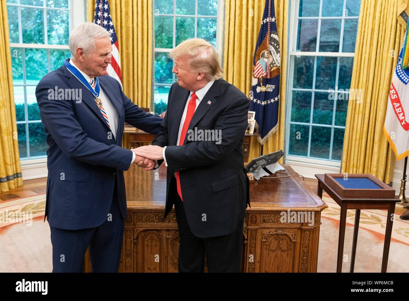 Washington, DC, USA. 05 September, 2019. U.S President Donald Trump congratulates Hall of Fame Los Angeles Lakers basketball star and legendary NBA General Manager Jerry West following the awarding of the Presidential Medal of Freedom, during a ceremony in the Oval Office of the White House September 5, 2019 in Washington, DC. Stock Photo