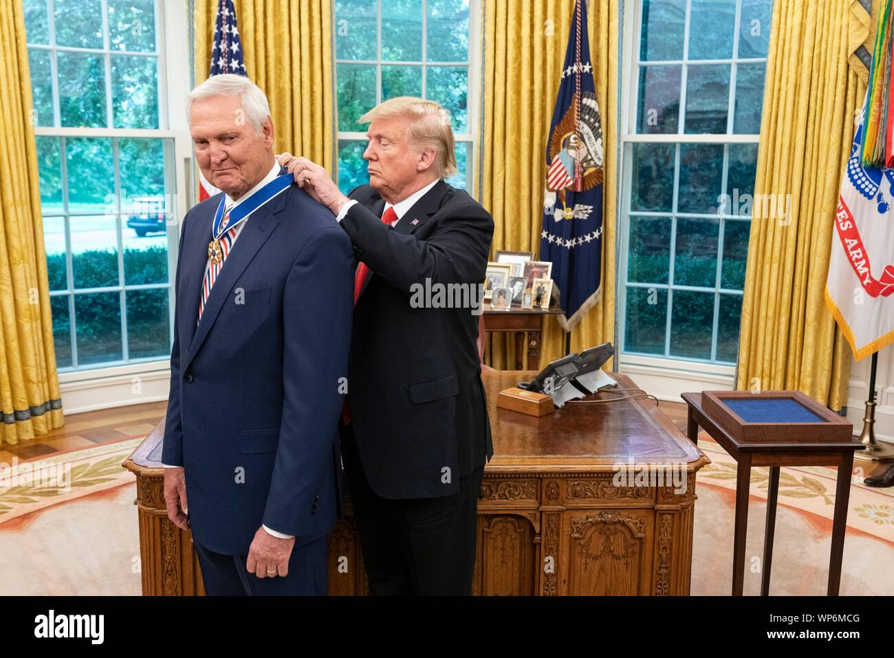 Washington, DC, USA. 05 September, 2019. U.S President Donald Trump, right, presents the Presidential Medal of Freedom, to Hall of Fame Los Angeles Lakers basketball star and legendary NBA General Manager Jerry West during a ceremony in the Oval Office of the White House September 5, 2019 in Washington, DC. Stock Photo