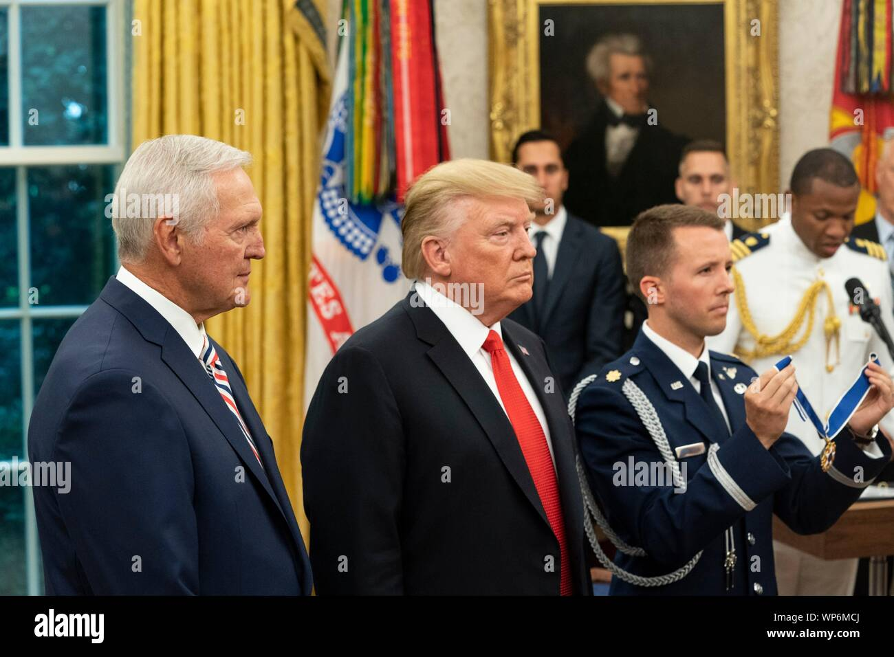 Washington, DC, USA. 05 September, 2019. U.S President Donald Trump, center, awards the Presidential Medal of Freedom, to Hall of Fame Los Angeles Lakers basketball star and legendary NBA General Manager Jerry West during a ceremony in the Oval Office of the White House September 5, 2019 in Washington, DC. Stock Photo
