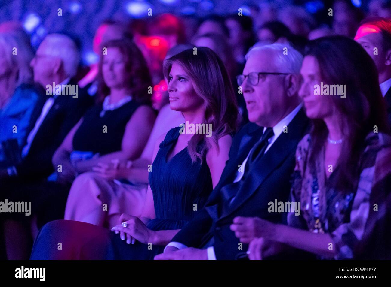Washington, DC, USA. 05 September, 2019. U.S. First Lady Melania Trump applauds during the REACH performance at the John F. Kennedy Center for the Performing Arts September 5, 2019 in Washington, D.C. Sitting with the First Lady is David Rubenstein, right, co-founder of the Carlyle Group. Stock Photo