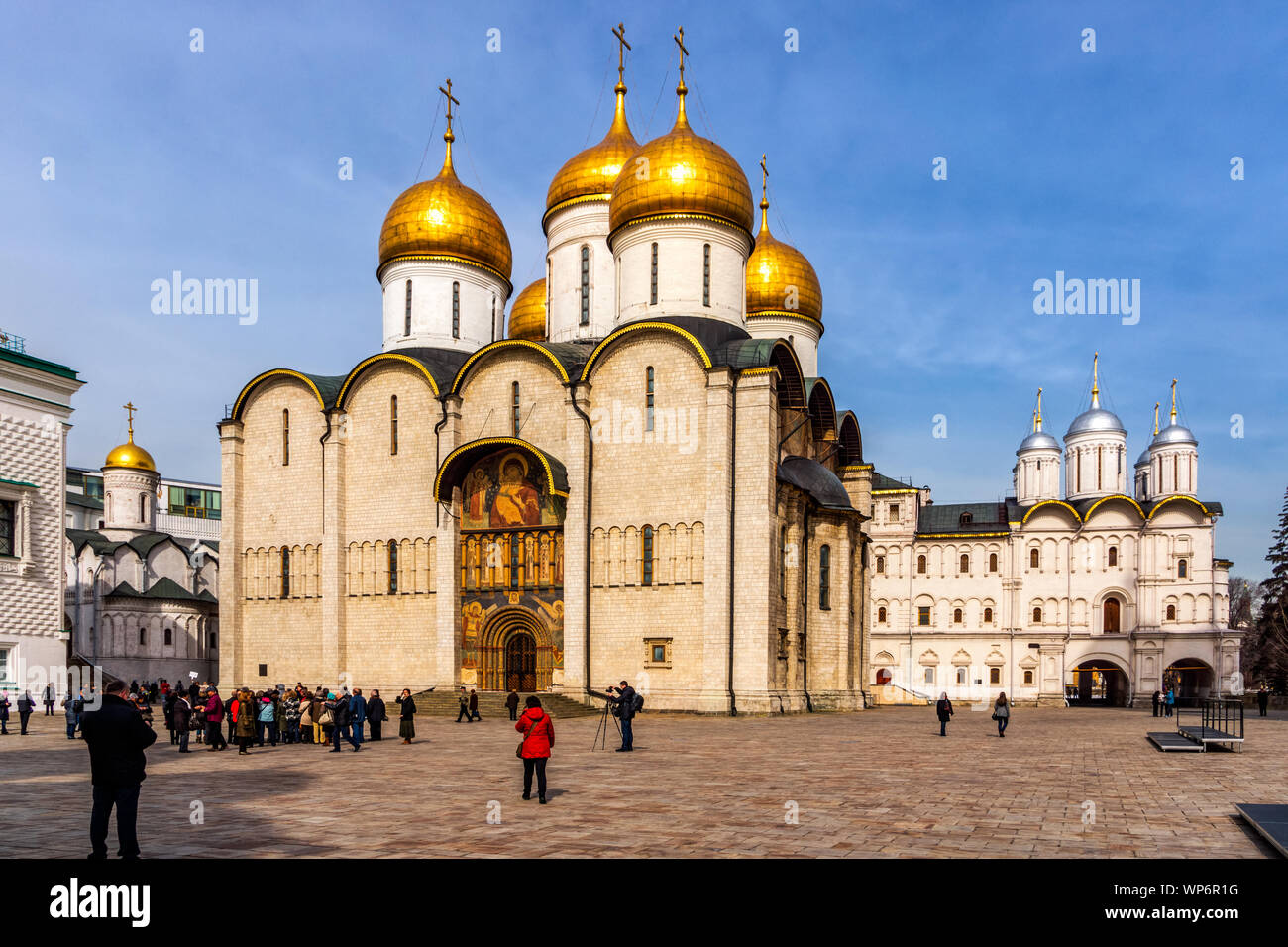 Moscow, Russia, April 2013 Tourists visiting and photographing Cathedral of the Dormition also known as Cathedral of the Assumption in Kremlin Stock Photo