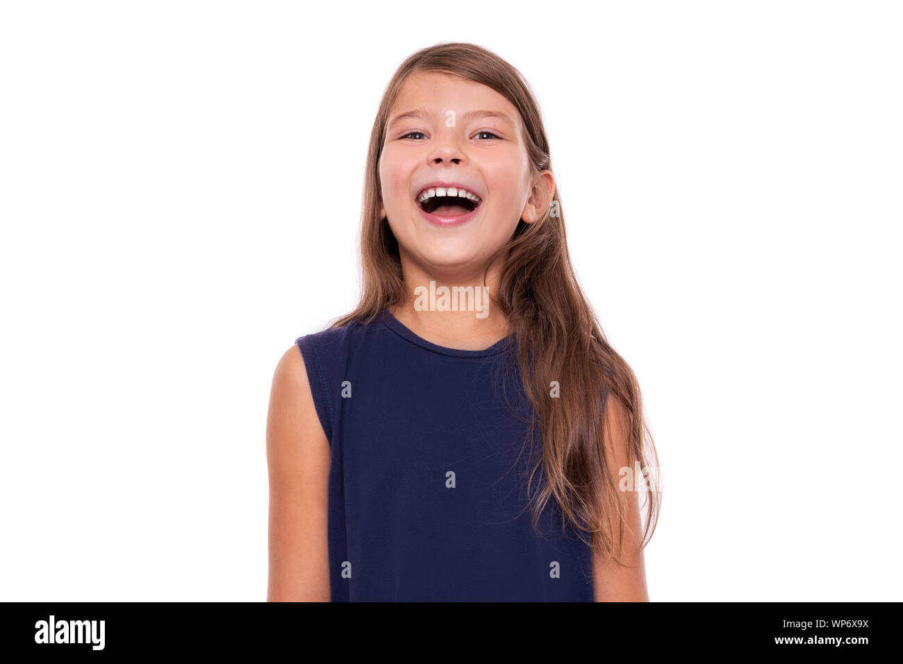 Portrait of a young smiling girl on a white. Stock Photo