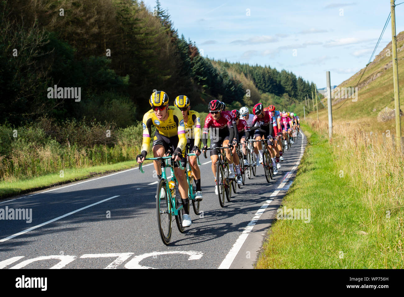 Dalmellington, Scotland, UK - September 7, 2019: Competitors in the OVO Energy Tour of Britain cycle race during stage one as they make their way through south Ayrshire towards the finish in Kirkcudbright, Dumfries and Galloway. Stock Photo