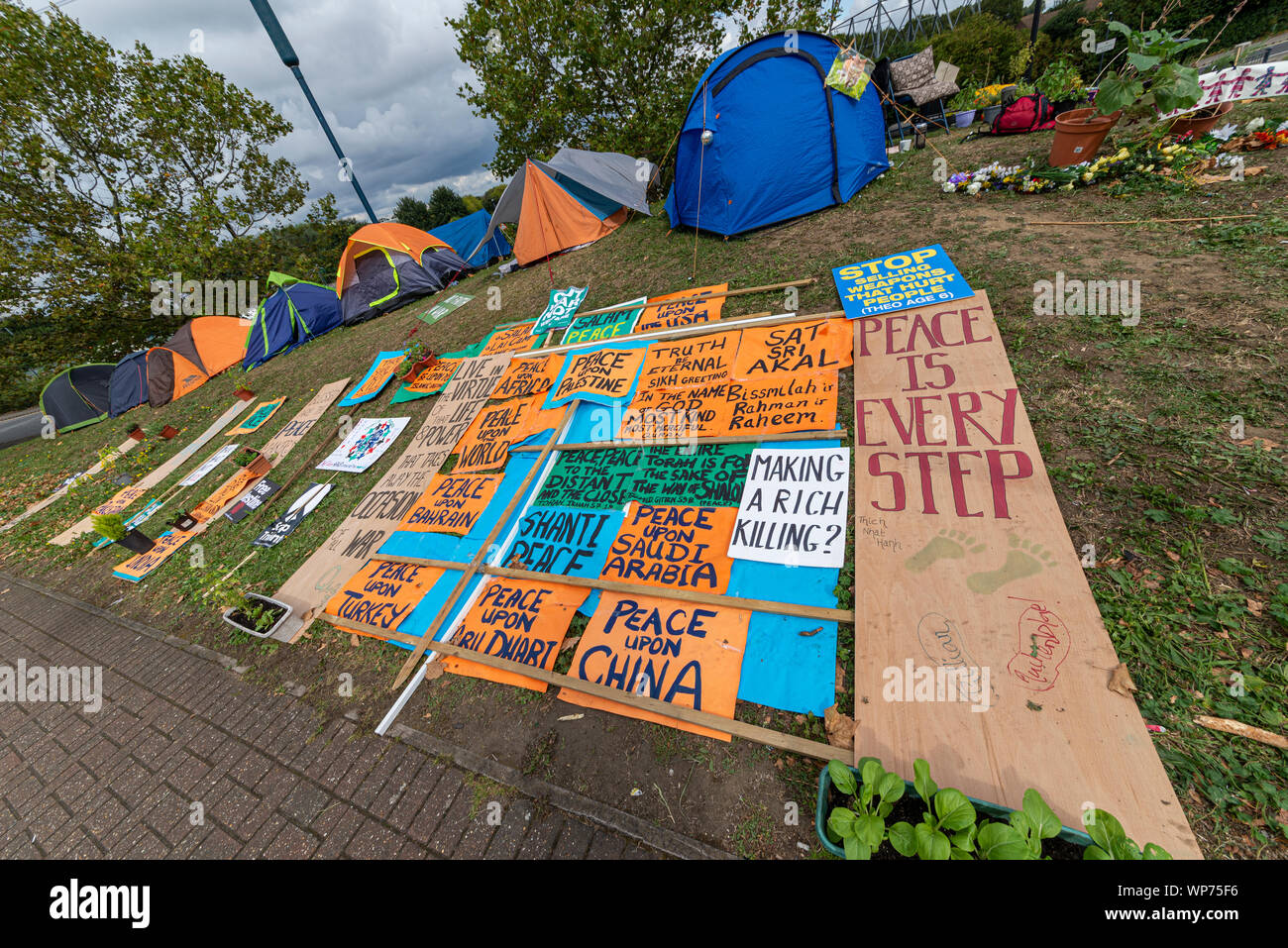 Protest encampment at Defence & Security Equipment International DSEI arms fair trade show, ExCel, London, UK. Protesters tents. Camp. Placards Stock Photo