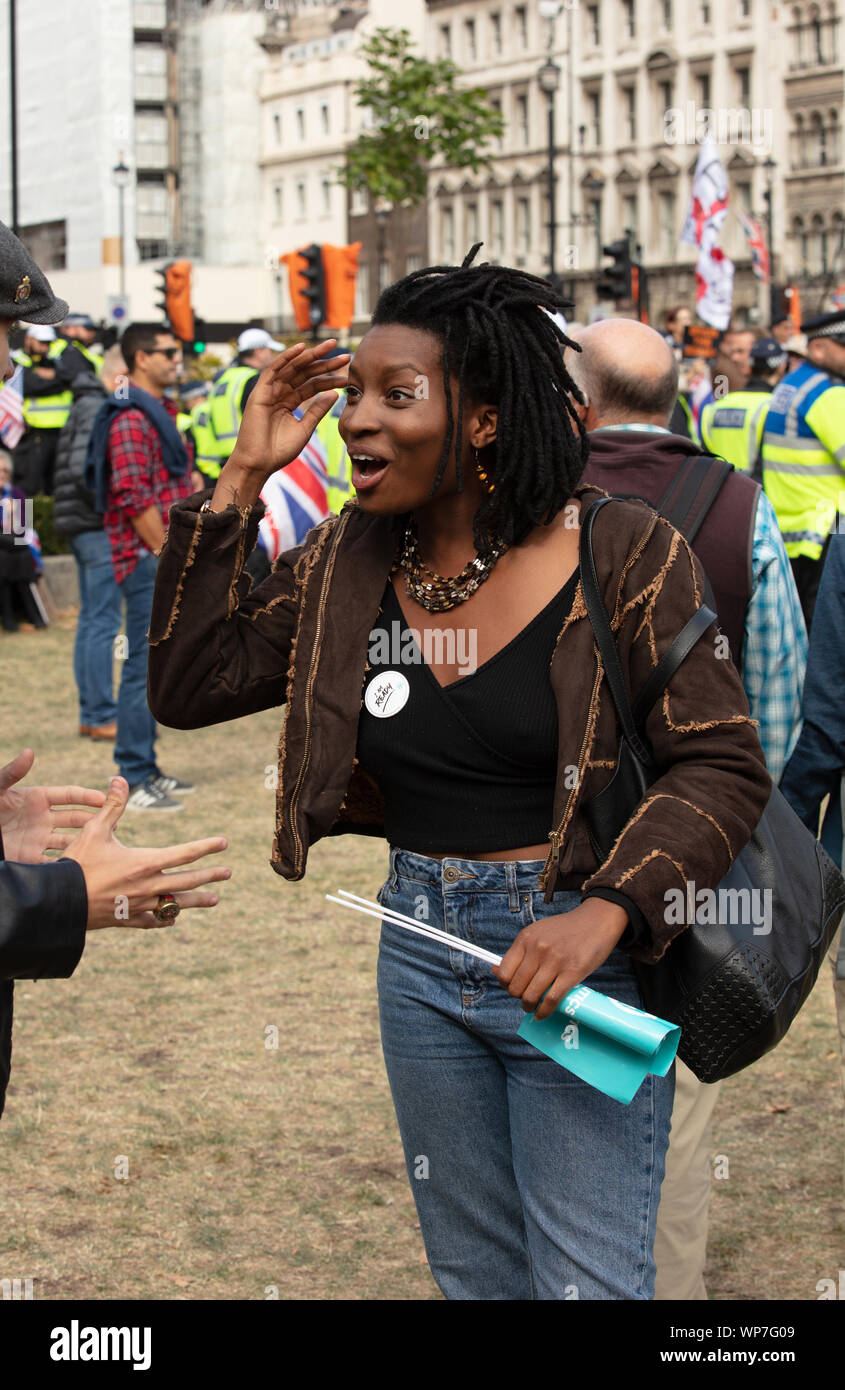 London, UK. 7th September 2019. Miss Inaya Folarin minutes after she is allegedly told she is a racist by a anti-Brexit demonstrator at the anti-Brexit and pro-Brexit demonstration, because of her joining the Brexit Party. Credit: Joe Kuis / Alamy News Stock Photo