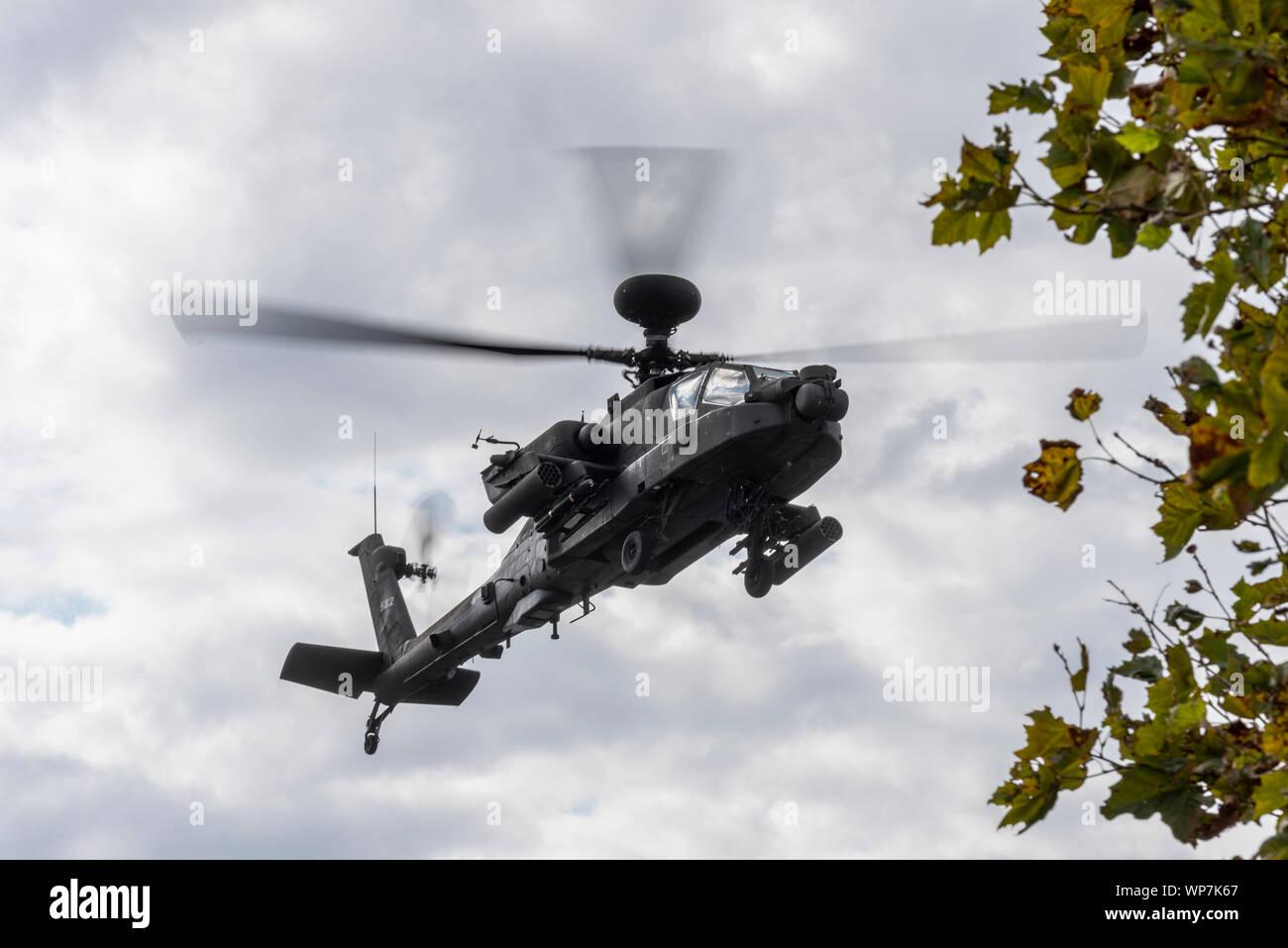 US Army AH-64 Apache gunship landing at Defence & Security Equipment International DSEI arms fair trade show, ExCel, London, UK Stock Photo