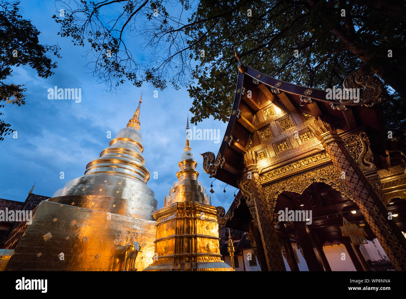 Golden pagoda in Wat Phra Singh temple. Chiang Mai, Thailand. Stock Photo