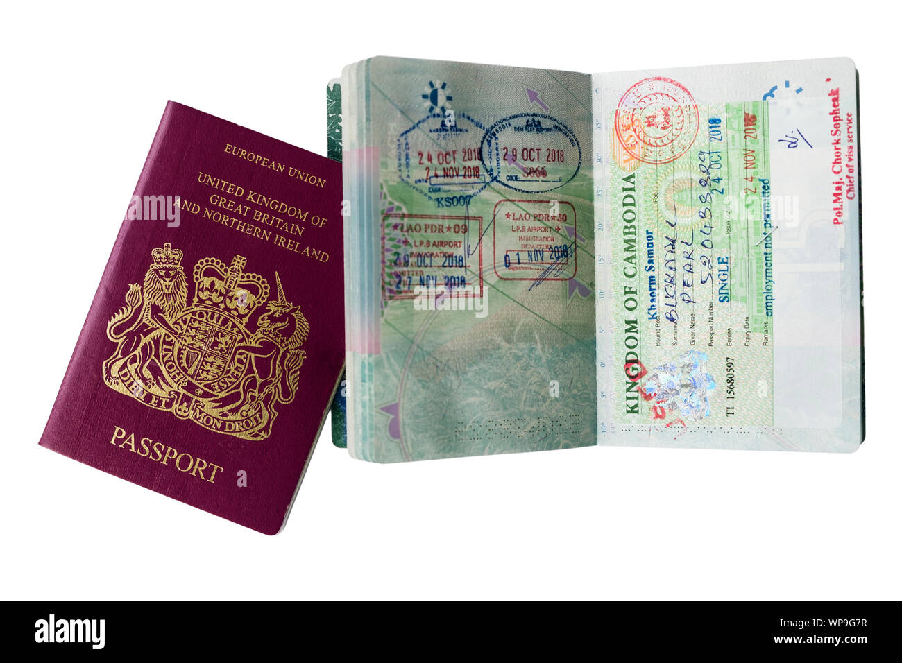 European Union British Passport for United Kingdom and Northern Ireland with Cambodia visa and Lao stamps on open pages isolated on white. England UK Stock Photo