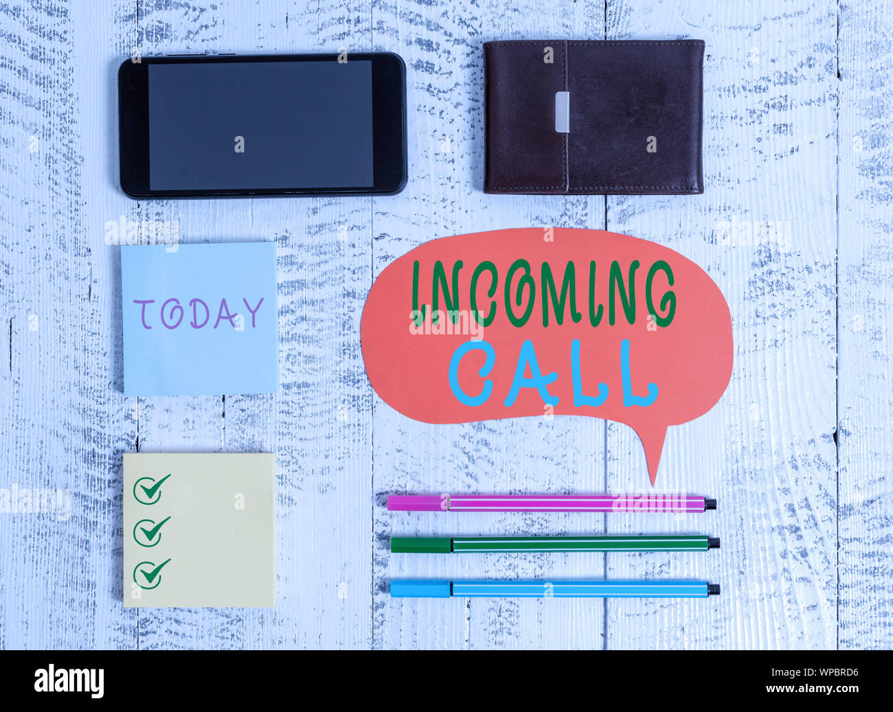 Word writing text Incoming Call. Business photo showcasing Inbound Received Caller ID Telephone Voicemail Vidcall Smartphone pens blank speech bubble Stock Photo