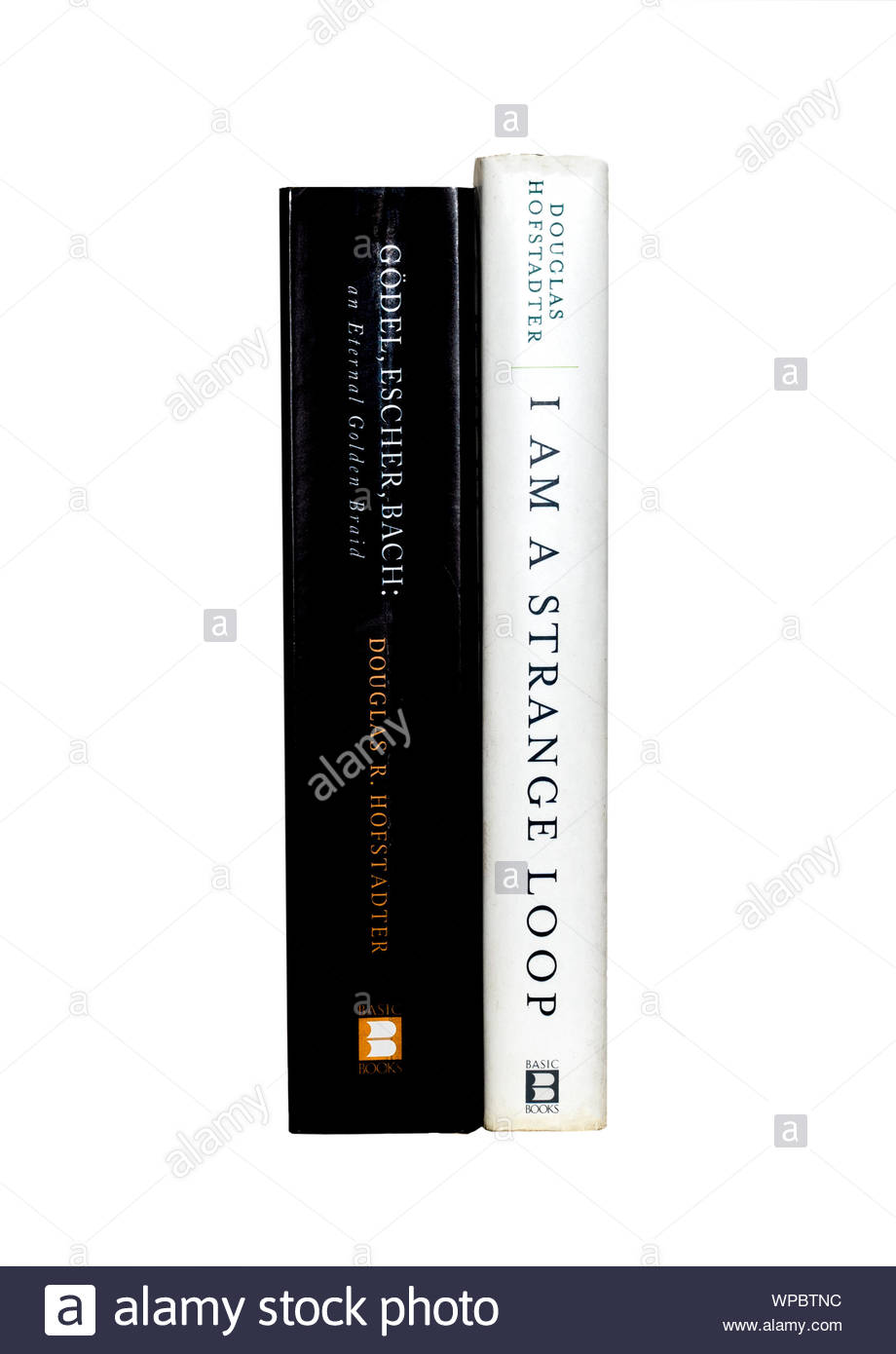 "BOOK IMAGE:  Copies of Douglas Hofstadter's ""Godel, Escher, Bach"", and ""I am a Strange Loop"",  with spines showing.  Isolated on white background. Stock Photo"