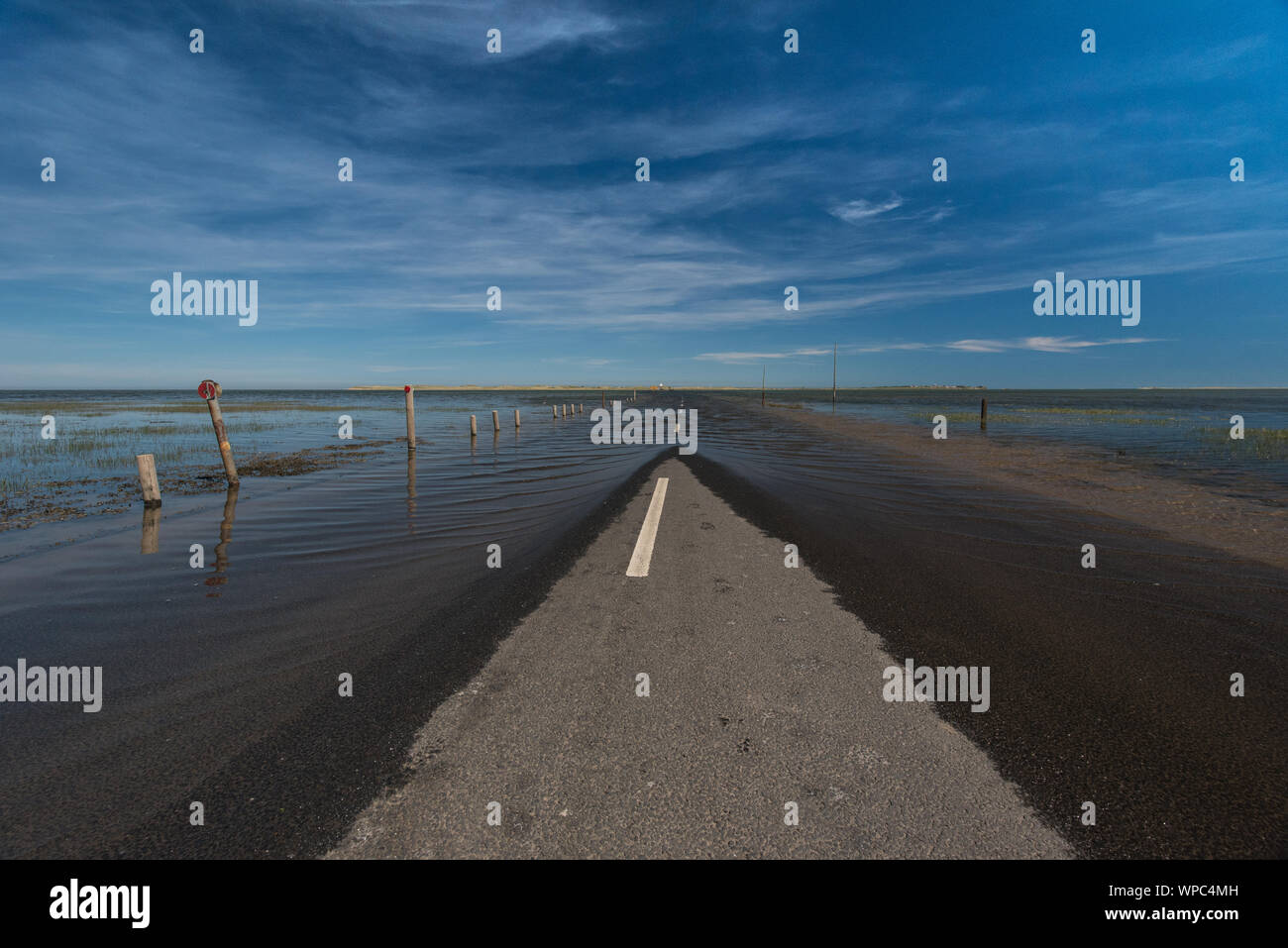 Road to nowhere in East-Scotland, overflooded by the sea tide, Holy Island. Stock Photo