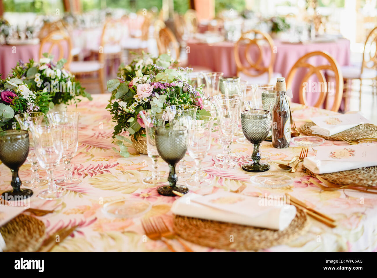Elegant Cutlery And Floral Arrangements For A Table In A Wedding Restaurant With Vintage Style Centerpieces Stock Photo Alamy