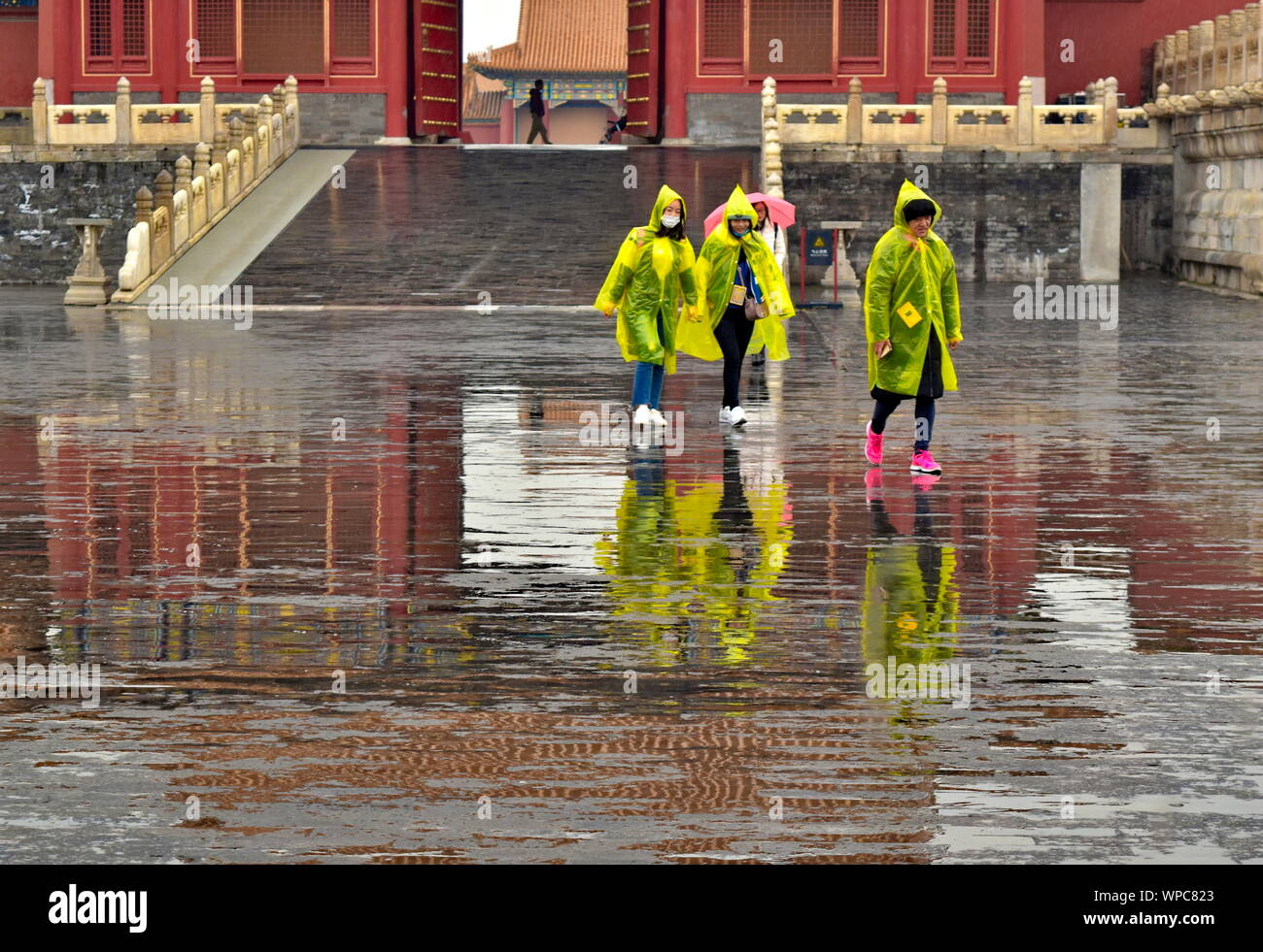 Landmark Chinese architecture of Forbidden City palace gate water reflected on rain puddles, Beijing, China Stock Photo